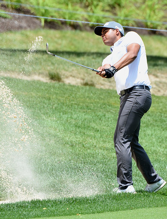Sabastian Munoz hits from the trap on the 9th hole during the second round of The Greenbrier Classic.<br /> (Rick Barbero/The Register-Herald)