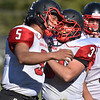 (Brad Davis/The Register-Herald) Oak Hill's Christian Lively is congratulated by teammate Casey Wood after making a big defensive play Saturday afternoon in Shady Spring.