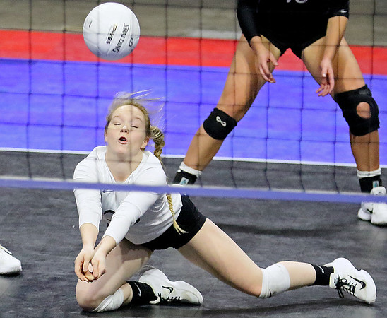 (Brad Davis/The Register-Herald) James Monroe's Kelli Ellison dives to successfully make a difficult return against Robert C. Byrd during State Volleyball Tournament action Friday afternoon at the Charleston Civic Center.