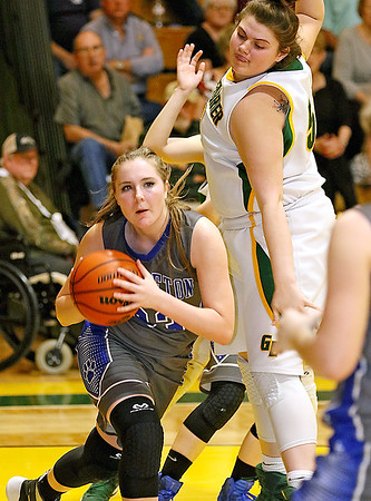 (Brad Davis/The Register-Herald) Princeton's Autumn Bradley looks for an open teammate after collecting a defensive rebound as Greenbrier East's Piper Nunley defends during Friday night's sectional championship game in Fairlea.