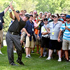 (Brad Davis/The Register-Herald) The crowd has to make way for Phil Mickelson as he shoots from the rough after an errant shot hit a fan during first round Greenbrier Classic action Thurdsay afternoon in White Sulphur Springs.