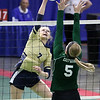 (Brad Davis/The Register-Herald) Greenbrier West's Kenley Posten spikes the ball as East Hardy's Brooke Miller tries to block it during State Volleyball Tournament action Friday morning at the Charleston Civic Center.