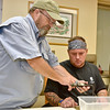 (Brad Davis/The Register-Herald) Healing Waters Program Director Al Cox, left, helping veteran chris Wyatt during a fly making session October 13 at the V.A. Medical Center.