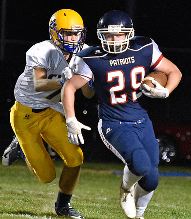 (Brad Davis/The Register-Herald) Independence's Trey Gunnoe carries the ball against Clay County Friday night in Coal City.
