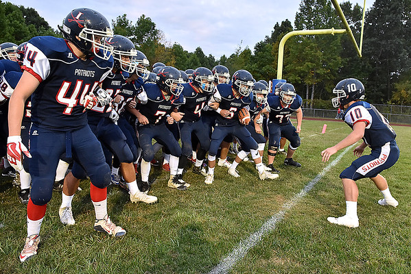 (Brad Davis/The Register-Herald) Independence's Connor Gibson (#10) fires up his Patriot teammates before leading them onto the field Friday night in Coal City.