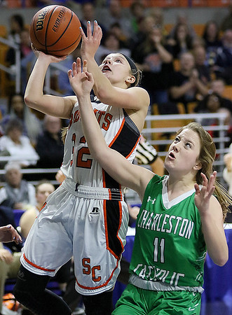 (Brad Davis/The Register-Herald) Summers County's Whittney Justice drives and scores as Charleston Catholic's Anna Hewitt defends during the Lady Bobcats' opening round State Tournament win over the Irish Wednesday evening at the Charleston Civic Center.