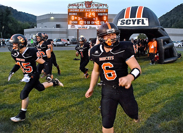 (Brad Davis/The Register-Herald) The Summers County Bobcats take the field for a home game against Greenbrier West Friday night in Hinton.