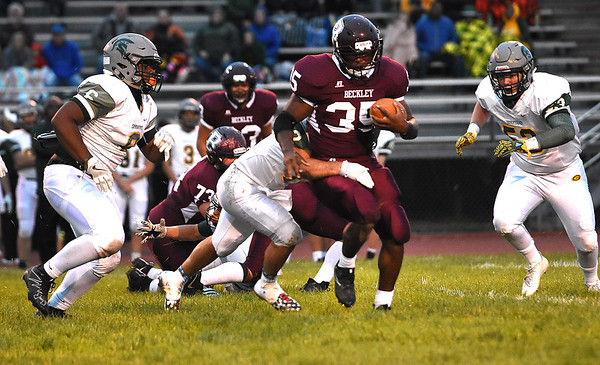 Tyree Swafford, 35, of Woodrow Wilson, breaks away from Greenbrier East defenders during game Friday night at Van Meter Stadium in Beckley.<br /> (Rick Barbero/The Register-Herald)