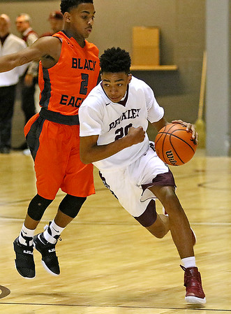 (Brad Davis/The Register-Herald) Woodrow Wilson's Mikey Penn hustles around South Charleston's Shazaun Cunningham at mid court Wednesday night at the Beckley-Raleigh County Convention Center.