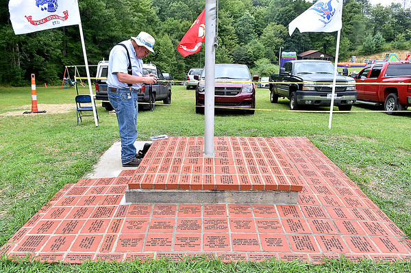 (Brad Davis/The Register-Herald) Cool Ridge resident Melvin Keaton, whose grandmother was a Lilly, photographs a memorial Saturday afternoon. He almost never misses a reunion and has been to so many, he's lost count.