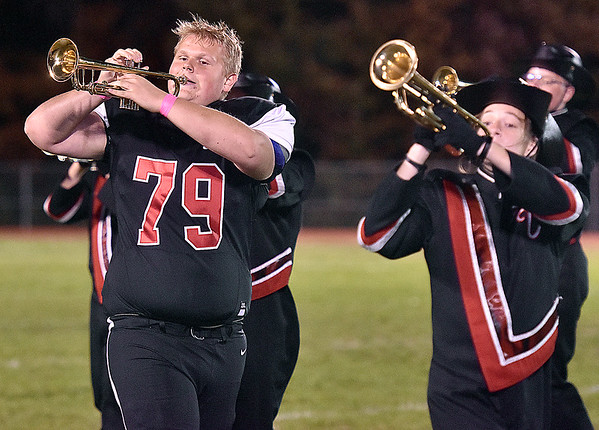 (Brad Davis/The Register-Herald) PikeView player Logan Krauss joins his other team, the marching band, for the Panthers' halftime show Friday night in Gardner.