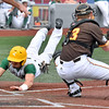 (Brad Davis/The Register-Herald) Miners baserunner Colby Johnson dives in to score a run before Kokomo catcher Bailey Partlow can turn around and tag him Friday night at Linda K. Epling Stadium.