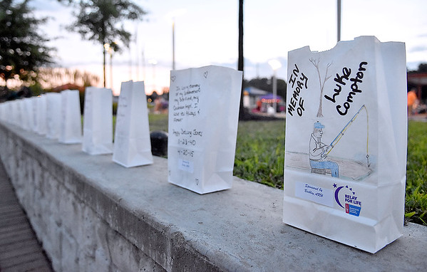 (Brad Davis/The Register-Herald) Hundreds of memorial luminaries line the walls atop Beckley's Intermodal Gateway during the late stages of the American Cancer Society's Relay for Life Friday night.