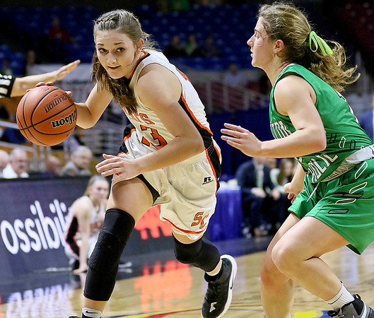 (Brad Davis/The Register-Herald) Summers County's Hannah Taylor drives to the basket during the Lady Bobcats' opening round State Tournament win over Charleston Catholic Wednesday evening at the Charleston Civic Center.