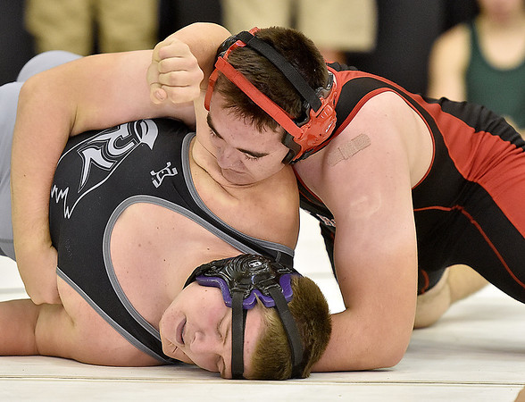(Brad Davis/The Register-Herald) Oak Hill's Elijah Evans takes on Riverview's Dustin Roberts in 220-pound weight class matchup during the Raider Rumble Saturday afternoon in Glen Daniel. Oak Hill's Evans would pin Roberts to win the match.
