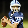 Meadow Bridge quarterback Lukas Stephens looked for a receiver while rolling out gf the pocket during their high school football game against Webster County Friday in Meadow Bridge. (Chris Jackson/The Register-Herald)