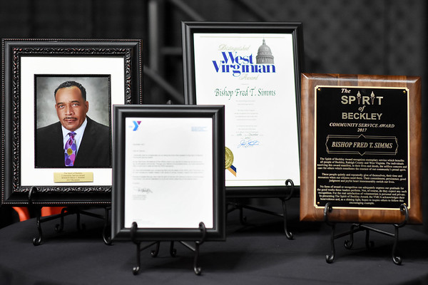 Awards for Bishop Fred T. Simms during the 31st annual Spirit of Beckley Award at the Beckley-Raleigh County Convention Center in Beckley on Monday. (Chris Jackson/The Register-Herald)