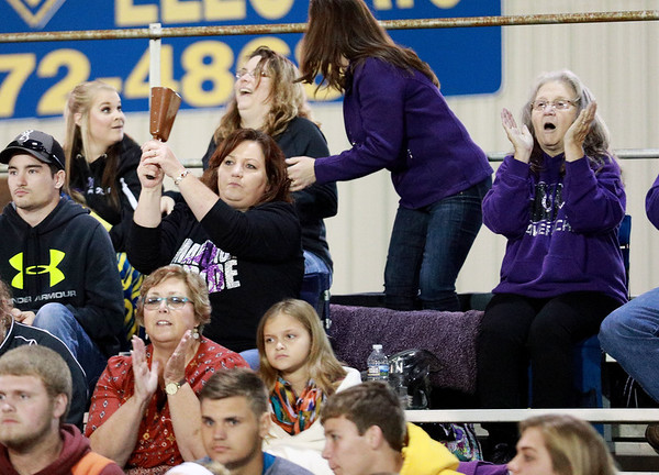 A James Monroe fan rings a cowbell after a play during their game against Nicholas County Friday in Summersville. (Chris Jackson/The Register-Herald)