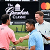 Davis Love lll, right, shakes hands with, Robert Streb, left and K.J. Choi after finishing his round at 7 under par on the 18th hole during the first round of The Greenbrier Classic.<br /> (Rick Barbero/The Register-Herald.com