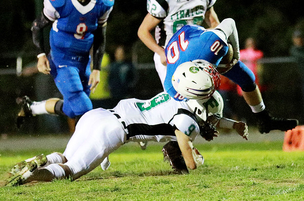 Fayetteville's Jordan Dempsey (9) tackles Midland Trail's (10) during their high school football game Friday in Hico. (Chris Jackson/The Register-Herald)