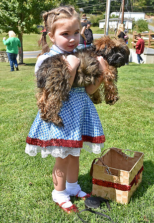 (Brad Davis/The Register-Herald) Dorothy and Toto, a.k.a. two-year-old Bella Graham and her dog Luke, show up in a full Wizard of Oz theme for the Kids Classic Dazzling Dog Show Sunday afternoon at the Youth Museum.