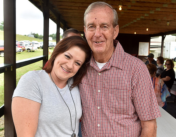(Brad Davis/The Register-Herald) Second cousins Waddell and Paula Lilly pose for a quick photo during the annual Lilly Family Reunion Saturday afternoon near Ghent.
