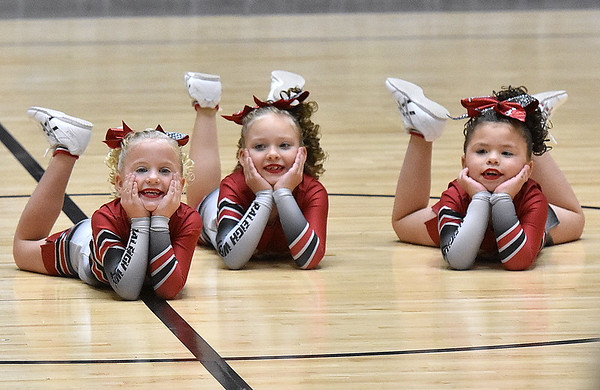 (Brad Davis/The Register-Herald) The The Raleigh West Raiders seven through nine-year-old team performs during a regional cheerleading competition featuring 16 teams at the Beckley-Raleigh County Convention Center Sunday afternoon.