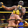 (Brad Davis/The Register-Herald) Beckley's Timotheus Graham catches a left handed jab on the chin from Cross Lanes' Bobby Brown (back turned) during Original Toughman action Saturday night at the Beckley-Raleigh County Convention Center. Brown would win the fight.
