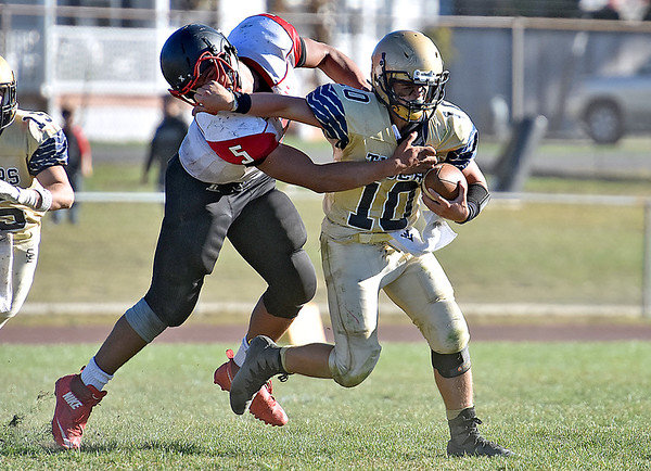 (Brad Davis/The Register-Herald) Shady Spring quarterback Drew Clark is caught and sacked in the backfield by Oak Hill's Christian Lively during the Tigers' desperate final drive of their homecoming game Saturday afternoon in Shady Spring.