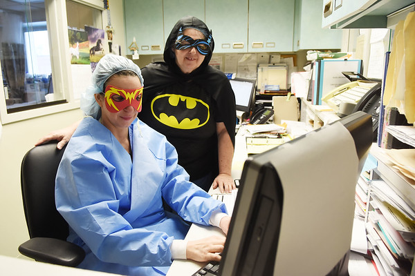 Barbara Clay and Teresa Ornold, both nurses at Appalachia Regional Hospital in Beckley, dress up like superheroes on the job for Nurses Week. (Chris Jackson/The Register-Herald)