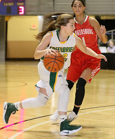 (Brad Davis/The Register-Herald) Greenbrier East's Taylor Hardiman drives as Parkersburg's Hannah Carroll defends during Big Atlantic Classic action Saturday afternoon at the Beckley-Raleigh County Convention Center.