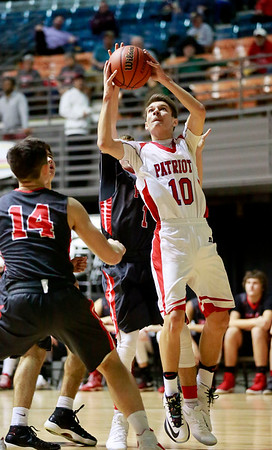 Independence's Kyle Saunders (10) goes up for a layup over two Poca players during the Big Atlantic Classic on Tuesday. (Chris Jackson/The Register-Herald)