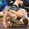 (Brad Davis/The Register-Herald) Liberty's Aaron Clark takes on Shady Spring's Tyler Worrells in a 145-pound weight class matchup Saturday afternoon at Shady Spring High School. Liberty's Clark won the match.