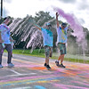 (Brad Davis/The Register-Herald) Participants relish in the color as they're doused with it during the United Way of Southern West Virginia's annual Color Me United Walk/Run Saturday morning at the Raleigh County Memorial Airport.