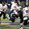 James Monroe's Grant Mohler (20) tackles Nicholas County's Tyler Sedlock (30) during their high school football game Friday in Summersville. (Chris Jackson/The Register-Herald)