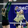 (Brad Davis/The Register-Herald) Greenbrier West's sends the ball across as East Hardy's Booke Miller tries to block it during State Volleyball Tournament action Friday morning at the Charleston Civic Center.