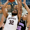 (Brad Davis/The Register-Herald) Woodrow Wilson's Tarek Payne drives to the basket as Riverside's T.J. Wood defends during the Flying Eagles' win over the Warriors Wednesday night at the Beckley-Raleigh County Convention Center.