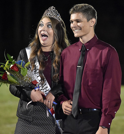 (Brad Davis/The Register-Herald) New Indy Homecoming Queen Madison Testement reacts to friends and family snapping photos of her an escort Kyle Saunders during halftime Friday night in Coal City.