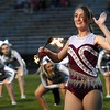 Brooklyn Branham, majorette for Woodrow Wilson High School, performs on the field before game against Cabell Midland Friday night at Van Meter Stadium in Beckley.<br /> (Rick Barbero/The Register-Herald)