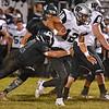 (Brad Davis/The Register-Herald) Westside's Matt Blankenship carries the ball Friday night in New Richmond.