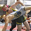 (Brad Davis/The Register-Herald) Greenbrier East's Levi Hobbs takes on Nicholas County's Jimmy Pritt in a 145-pound weight class matchup during the West Virginia Army National Guard Duals Friday afternoon at the Beckley-Raleigh County Convention Center. East's Hobbs won the match.