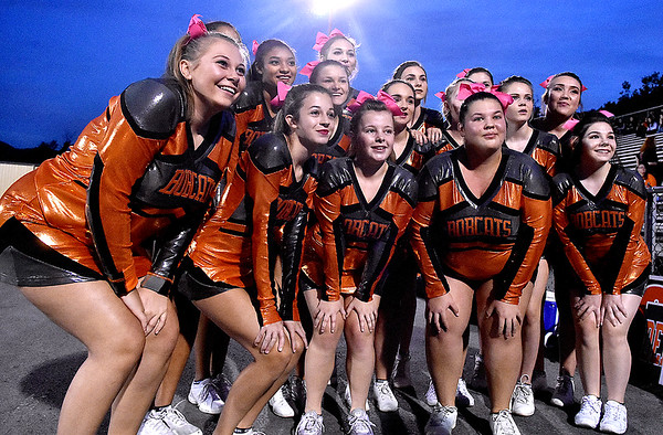 (Brad Davis/The Register-Herald) Summers County cheerleaders participate in a quick TV spot for a local channel prior to the Bobcats' home game against Independence Friday night in Hinton.
