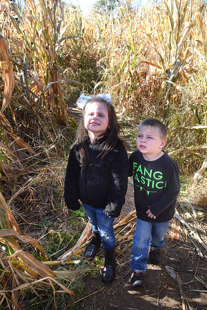 Kennedy Flowers, left, and Barkley Phillips, Pre-K students in Shannon Wooton's class, walk through the corn maze at the Okes Family Farm in Cool Ridge. Crescent Elementary Pre-K spent the day at the farm participating in the hay tunnels, corn maze, corn box, tractor ride to pumkin patch and the jump house. Oke's Family Farm is open during the week for school field trips and open to the public, Saturday 10 am to 5:30 p.m. and Sunday noon to 5:30 p.m.<br /> (Rick Barbero/Rick Barbero/The Register-Herald)