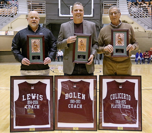 (Brad Davis/The Register-Herald) Woodrow Wilson basketball hall of fame inductees (from left) James Lewis, Bob Bolen and Pete Culicerto pose for a quick photo with their new hardware following a halftime ceremony during the Flying Eagles' game against Greenbrier East Saturday night at the Beckley-Raleigh County Convention Center.