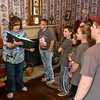 (Brad Davis/The Register-Herald) Bradley Elementary 5th graders and student council members get a tour of Wildwood House Museum, the former home of Beckley founder Alfred Beckley, prior to a Spring cleanup at the house Saturday afternoon.