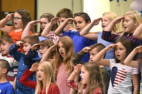 """Third grade class sang """"I Love My Country"""" during a Vereran's Day program held at Lester Elementary School Wednesday afternoon.<br /> (Rick Barbero/The Register-Herald"""