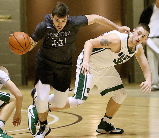 (Brad Davis/The Register-Herald) Independence's Logan Kelly takes off with a loose ball after scrambling for it with Wyoming East's Dylan Brehm during Big Atlantic Classic action Wednesday night at the Beckley-Raleigh County Convention Center.
