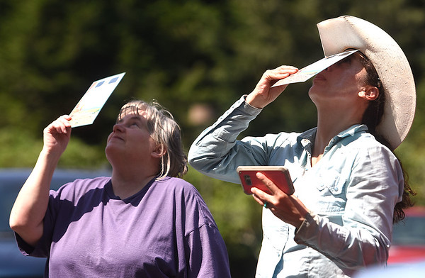 Sandy Moye, of Nimitz, left and Maximina Pate, of Daniels, looks at the solar eclipse Monday afternoon at Grandview State Park<br /> (Rick Barbero/The Register-Herald)