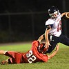 Andrew Milam, left of Liberty, tackles Connor Gibson, of Independence  during game  Friday night at Liberty High School.<br /> (Rick Barbero/The Register-Herald)