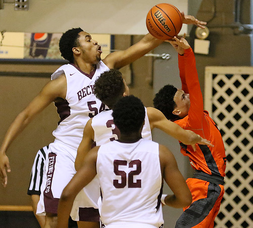 (Brad Davis/The Register-Herald) Woodrow Wilson's Brenton Walton unleashes a block on South Charleston's Cam Allen as he tries to drive to the basket Wednesday night at the Beckley-Raleigh County Convention Center.